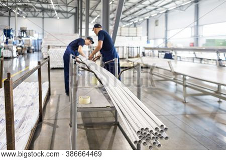 Factory Workers Engineer Checks The Quality Of Polypropylene Pipes