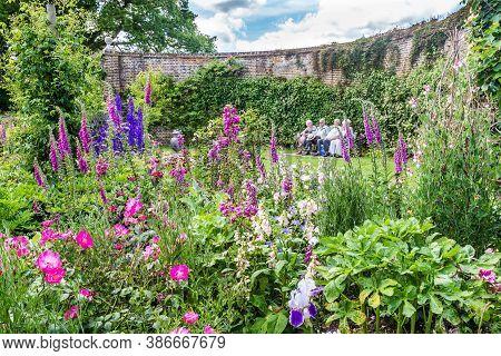 Sussex, Uk - June, 03, 2017: Elderly People Enjoying The Colorful British Castle Garden During Sprin