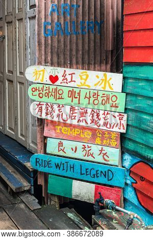 George Town, Penang, Malaysia - December 1, 2019: Arrow Wooden Authentic Sign With Fishing Village D