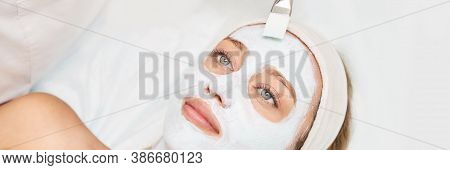 Portrait Of Moisturizing Mask On White Background For Medical Design. Woman Skin Procedure. Natural