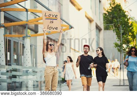 Love Is Love. Dude With Sign - Woman Stands Protesting Things That Annoy Her. Solo Demonstration Rig