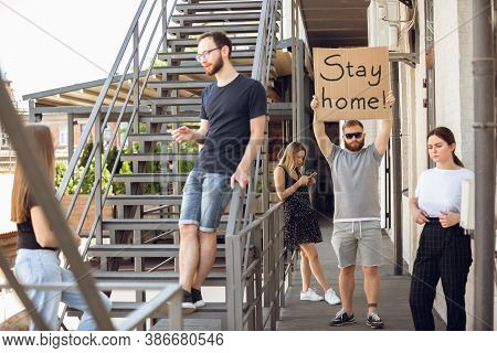 Stay Home. Dude With Sign - Man Stands Protesting Things That Annoy Him. Solo Demonstration His Righ
