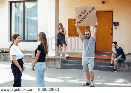 Dont Be Indifferent. Dude With Sign - Man Stands Protesting Things That Annoy Him. Solo Demonstratio
