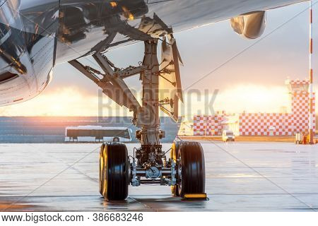 One Of The Main Landing Gear Under The Wing And Fuselage Of The Aircraft