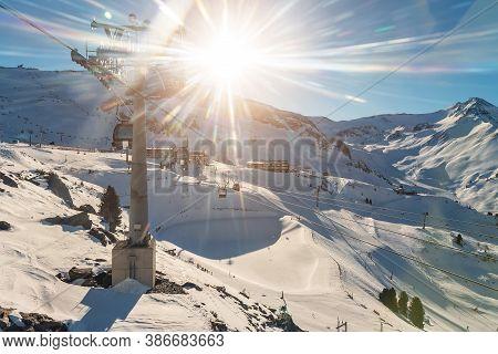 Panoramic View Idalp Skiing Area With Many Ski Slope, Pistes, Ski Chairlifts Gondola Against Mountai