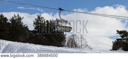 Panoramic View On Chair-lift And Snowy Off-piste Slope With Traces From Skis And Snowboards In Ski R