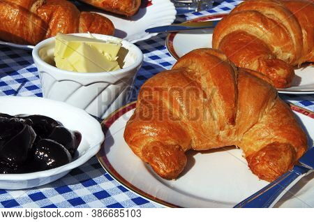 Croissants With Raspberry Jam And Butter On Fine Bone China Plates, Andalucia, Spain, Europe.