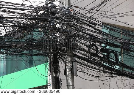 City Cable Mess In Asia - Tangled Mess Of Cables In Manila, Philippines.