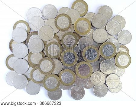 Pile Of Coins Of Belarusian Rubles, Denomination One And Two Rubles. Belarusian Money. Background