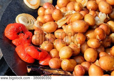 Grilled Baby Potatoes Served In A Metal Frying Pan, Vegan Take Away Cuisine. Street Festival Food.