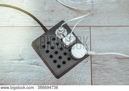 Beautiful Stylish Modern Extension Cord For Power Supply Of Devices Is On The Floor. Plug Is Plugged