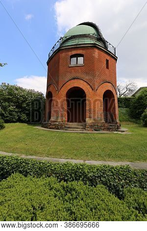 Old Astronomy Observatory Building Of Red Bricks With Green Cupola