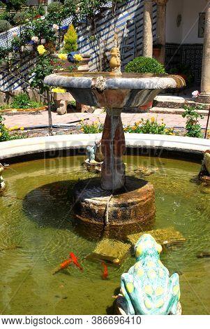 Ronda, Spain - May 13, 2008 - Fountain In The Pretty Gardens At Don Bosco House, Ronda, Malaga Provi