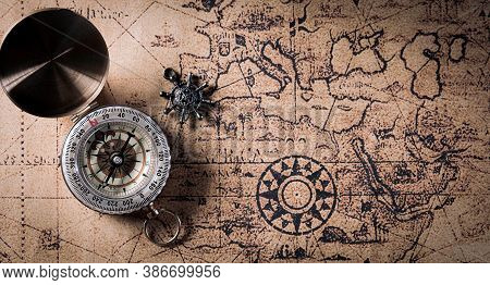 Happy Columbus Day Concept. Vintage Compass And Retro Treasure Manuscript.  Flat Lay, Top View With