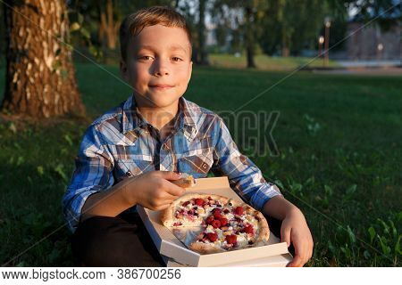 The Boy Eat A Piece Of Pizza.