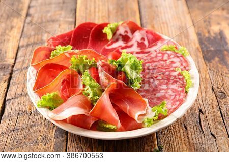assorted of meat slices- salami, bacon, ham