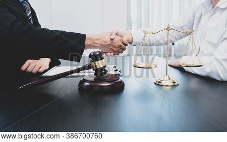 Shake Hand Professional Male Lawyers Work At A Law Office There Are Scales, Scales Of Justice, Judge