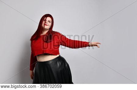 Plump Ginger In A Red Top With Spikes, A Bra With A Red Top And A Leather Skirt, Earrings. She Is Da