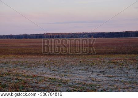 Sunset Sky Over The Agricultural Plain. Farmer Fields In The Evening. Plain Landscape.