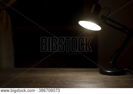 Lamp On Desk At Night, Free Space For Text.