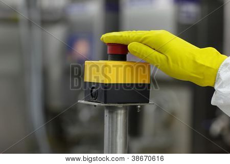 hand in glove pressing important technology button