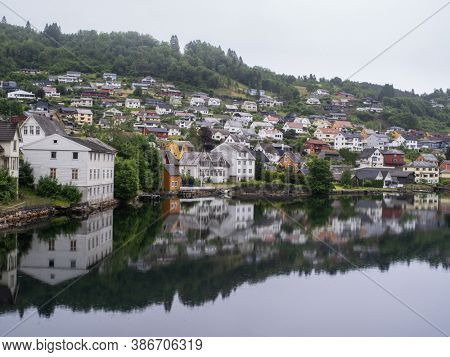 Cloudy summer view of Hardangerfjord and Norheimsund village, Norway, Europe