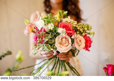 A Woman Florist Makes A Bouquet Of Bright Pink And Green Flowers In A Flower Shop.bouquet Of Pink Ro
