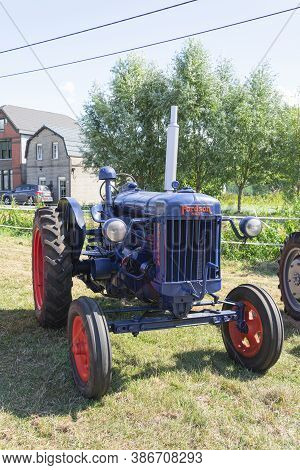 Kieldrecht, Belgium, September 1, 2019, Oldtimer Show With A Blue Tractor, More Specifically The 400