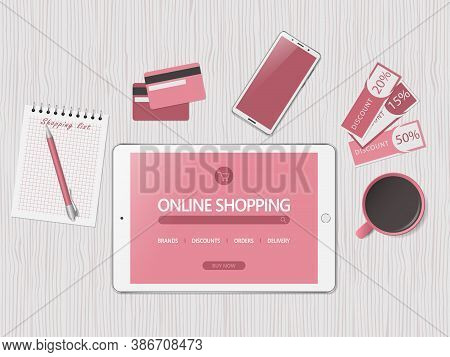 Online Shopping Concept. Online Store Website On Tablet Screen.. Workspace With Tablet, Credit Cards