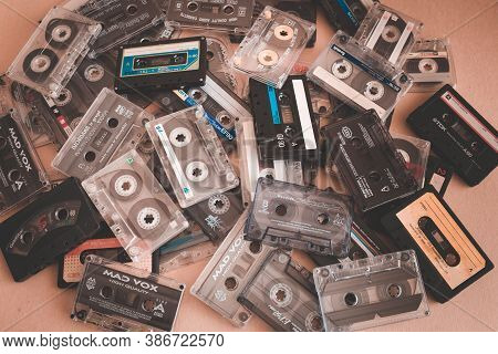 Top View Flat Lay Stack Vintage Few Compact Cassette Tape Set Of Old Audio Tapes On The Pink Backgro
