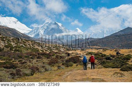 Tourist Trekking In Sagarmatha National Park With The Beautiful View Of Island Peak (6,819 Metres) O