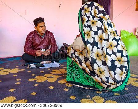 District Katni, India - January 16, 2020: Indian Village Women Seating For Micro Finance Loan Repaym