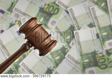 Judge Hammer On Euro Banknotes Background. Judges Gavel On Against Of Money. Corrupt Court
