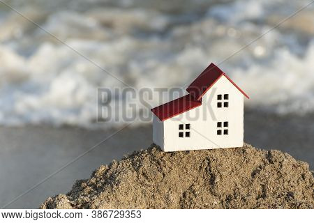 Model House On Sea Background. House By The Sea Concept. Villas For Sale, Houses.