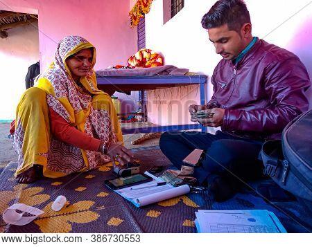 District Katni, India - January 16, 2020: Old Village Lady Finger Touching Electronic Thumb Pad Mach