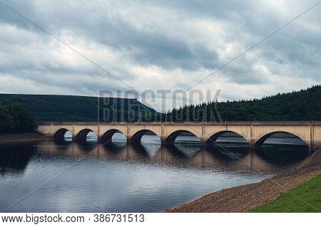 Bridge Over Lower Derwent Reservoir As It Joins Ladybower Reservoir In Peak District National Park,