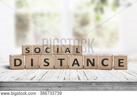 Message With Social Distance Information On A Wooden Table. Health Info About Keeping Distance In Th