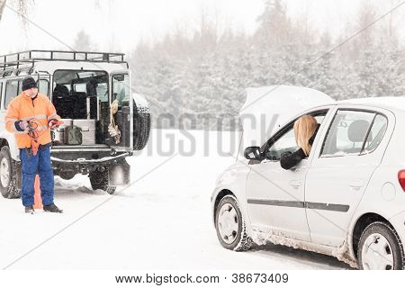 Winter car assistance man help woman breakdown snow road problem