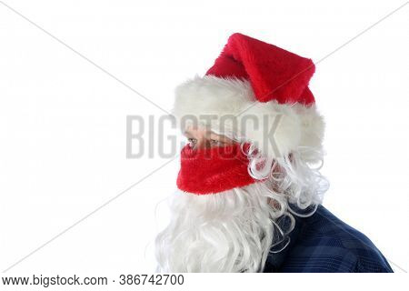 Casual Santa Claus Covid-19. Santa Wears a Blue Shirt, Santa Hat, Protective Face Mask on a causal day before Christmas. Isolated on white. Coronavirus is Dangerous even for Santa.