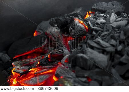 Red Hot Coal Nugget On Focus On Other Cold Raw Nuggets Of Coal. Background Of Raw Coals With Soft Fo