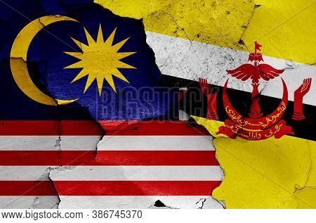 Flags Of Malaysia And Brunei Painted On Cracked Wall