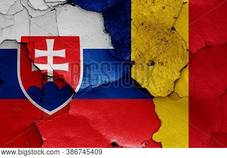 Flags Of Slovakia And Romania Painted On Cracked Wall