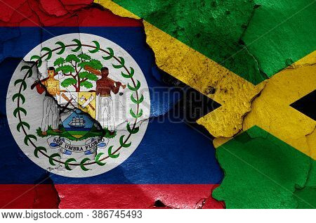 Flags Of Belize And Jamaica Painted On Cracked Wall