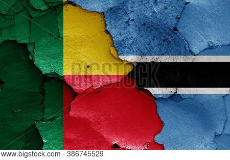 Flags Of Benin And Botswana Painted On Cracked Wall