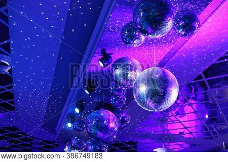 Disco Ball With Bright Rays, Night Party With Blue Background. Party Dance Hall Celebration At Night