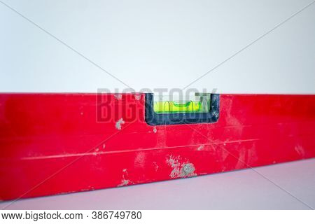 Building Tool Level. Red Water Level Tool Isolated On White Background. Concept. Copy Space.