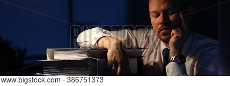 Portrait Of Smart Businessman Sitting Indoors And Closing Tired Eyes And Relaxing After Intense Tiri