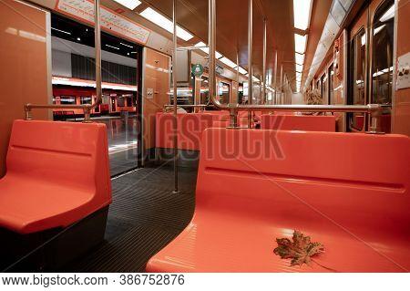 Helsinki, Uusimaa, Finland September 22, 2020 Metro In Helsinki, Maple Leaf Lies On The Bench. High