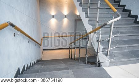 Indoor Staircase Step With Stainless Steel And Glass Handrail.