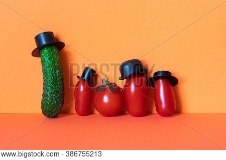 Mister Green Cucumber And Red Tomato Family. Funny Vegetables With Black Old Fashioned Hats. Creativ